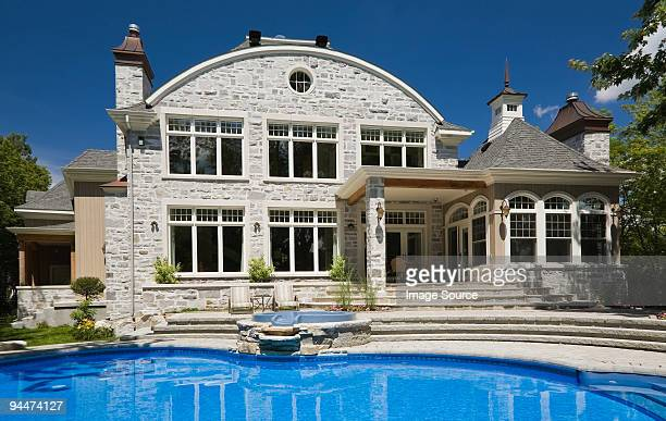 large house with swimming pool - laval canada stock pictures, royalty-free photos & images