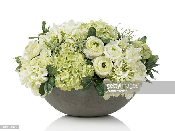 Large hydrangea bouquet in concrete bowl on white background