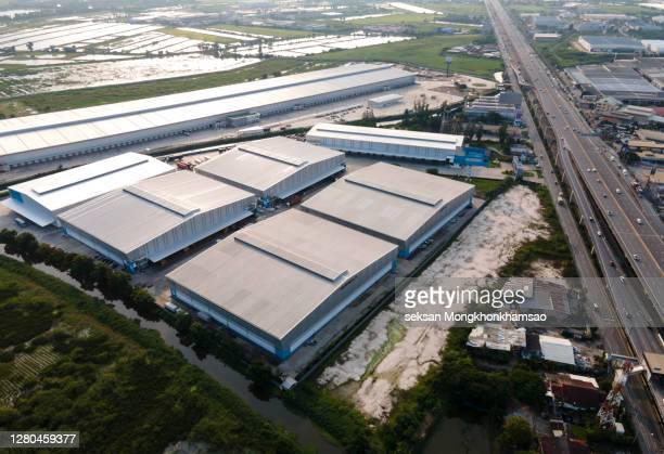 large industrial area, logistics industry buildings - aerial view - hub stock pictures, royalty-free photos & images