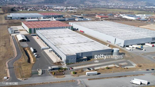Large industrial buildings roofs and trucks