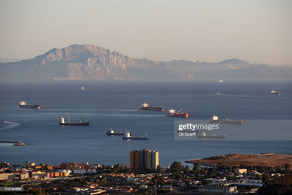 Large industrial ships wait in the Straight of Gibraltar adjacent to the Rock of Gibraltar, with Moroccan mountains on the skyline, on August 7, 2013 in San Roque, Spain. David Cameron has spoken with his Spanish counterpart, Mariano Rajoy, and Mr Rajoy has offered to 'reduce measures' at the Gibraltar border. Tensions between the British and Spanish governments have been raised on issues surrounding the sovereignty of Gibraltar. An increase in Spanish border crossing checks between the Rock and mainland Spain, leading to lengthy queues, is widely considered to be a retaliatory move for the construction of an artificial reef in British waters, which it is claimed has had a negative impact on Spanish fishing vessels in the area.