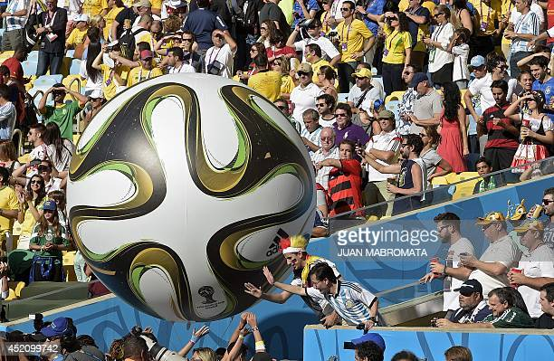A large inflatable Brazuca official ball of the 2014 FIFA World Cup is seen amongst fans prior to the 2014 FIFA World Cup final football match...