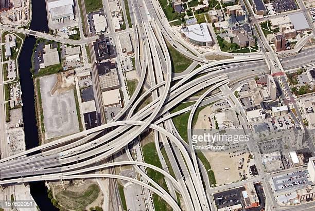 large interstate highway interchange in downtown milwaukee wisconsin - milwaukee stock pictures, royalty-free photos & images