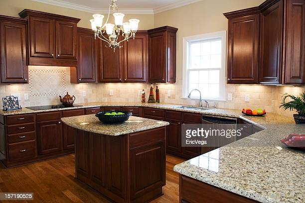 Large kitchen with a center island and granite countertops