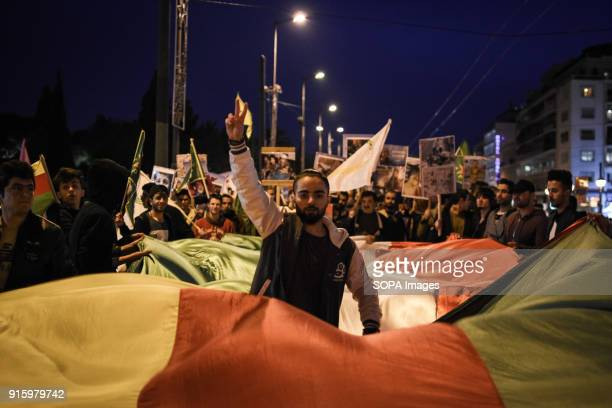 A large Kurdistan flag seen at the demonstration Kurds living in Athens marched toward the Turkish embassy the protest against the genocide happening...