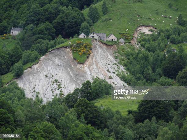 large landslide close to ancient rural settlement in vigezzo valley - landslide stock pictures, royalty-free photos & images