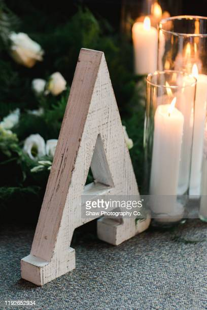 large letter a in front of wedding reception centerpiece - nature alphabet letters stock pictures, royalty-free photos & images
