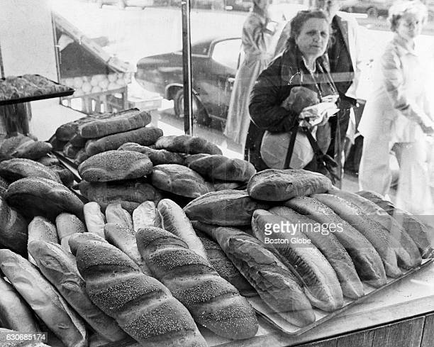 Large loaves of Italian bread are displayed in the window of Modern Pastry on Cross Street in Boston's North End on May 1 1978