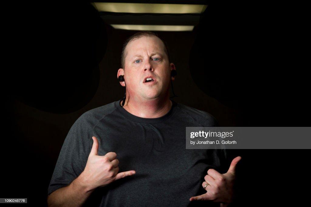 Large Man Running on Treadmill Having Fun : Stock Photo