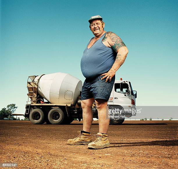 Large man standing by cement truck