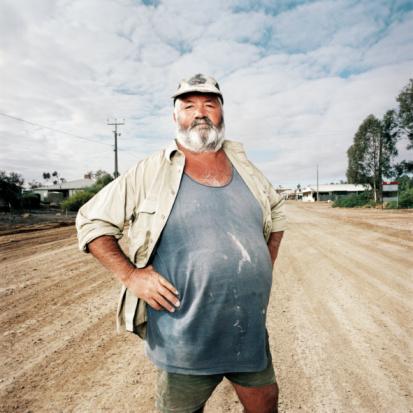 Large man standing on dirt road - gettyimageskorea