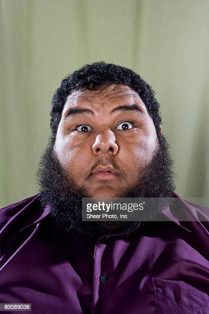 large man with surprised look on face  - fat black man stock photos and pictures