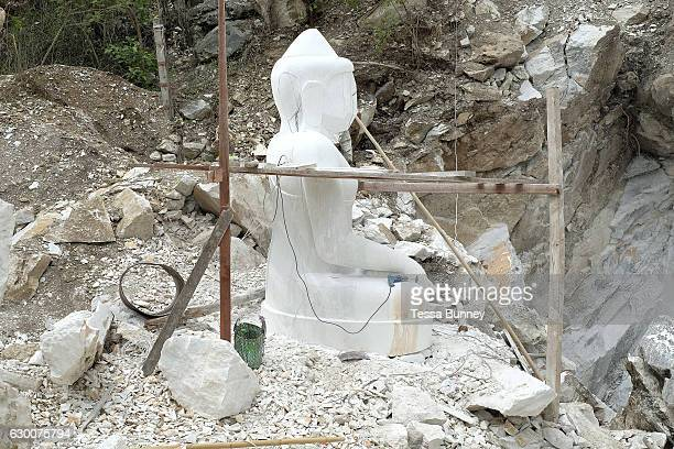 A large marble Buddha under construction at the Sagyin marble mine on 19th March 2016 in Mandalay division in Myanmar Sagyin a village 21 miles north...