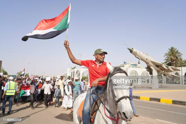 May 02: A large march of protesters makes its way into the protest site led by a horseman on May 02, 2019 in Khartoum, Sudan. Protests started at...