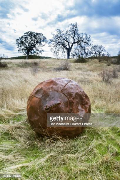 large metal ball used for smoothing out dirt roads in henry w. coe state park - koeberer stock photos and pictures