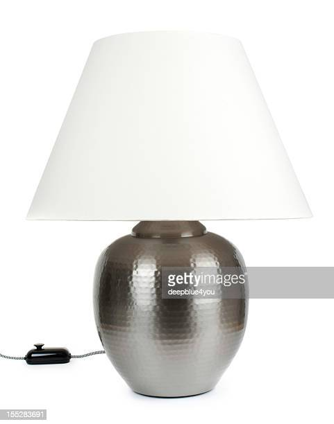 Large metall table lamp with white lampshade isolated