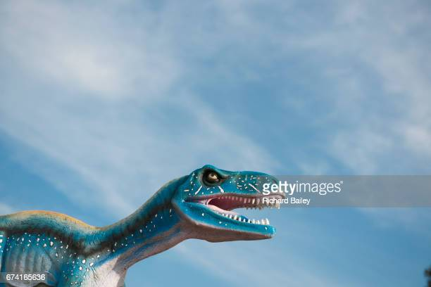 large model dinosaur - crazy holiday models stock photos and pictures