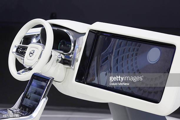 A large monitor opens from a dashboard as Volvo Concept 26 autonomous vehicle technology is presented at the 2015 Los Angeles Auto Show on November...