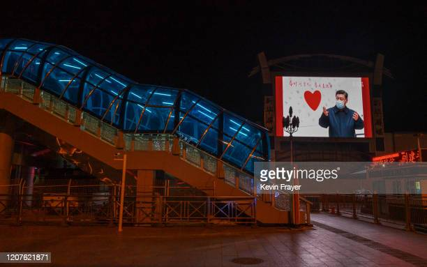 Large monitor shows an image of Chinese president Xi Jinping wearing a mask in the nearly empty Beijing Station on March 13, 2020 in Beijing, China....