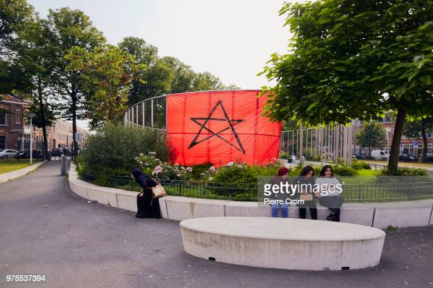 A large Moroccan flag is hung in Schilderswijk a neighborhood in The Hague where the DutchMoroccan community are supporting the Moroccan national...