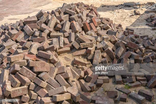 large mountain with pavers lying on a building site - heap stock pictures, royalty-free photos & images