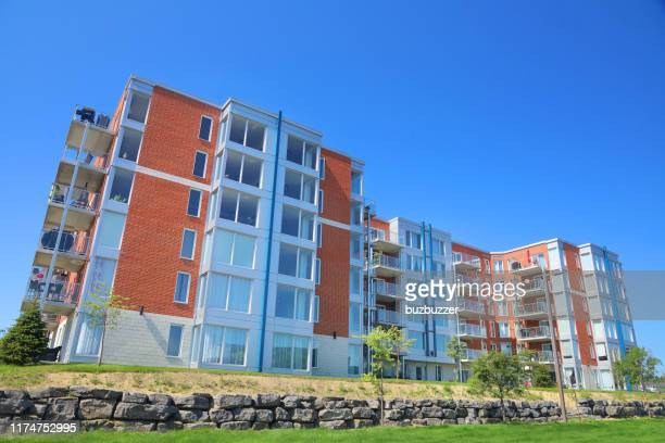 large multi-condos building block - buzbuzzer stock pictures, royalty-free photos & images