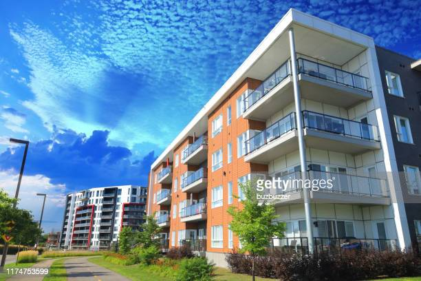 large multi-condos building blocks with bicycles lane and pedestrian walkway - buzbuzzer stock pictures, royalty-free photos & images