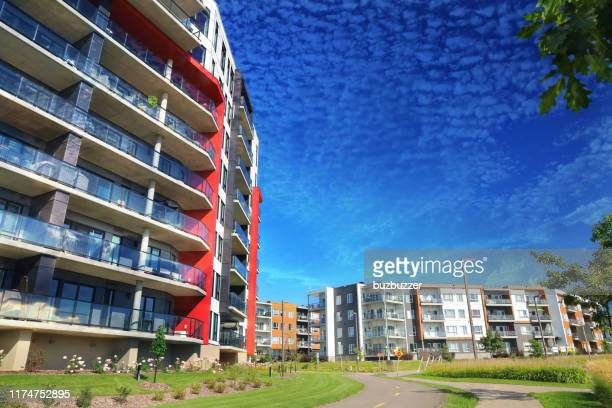 large multi-condos building blocks with bicycles lane - buzbuzzer stock pictures, royalty-free photos & images