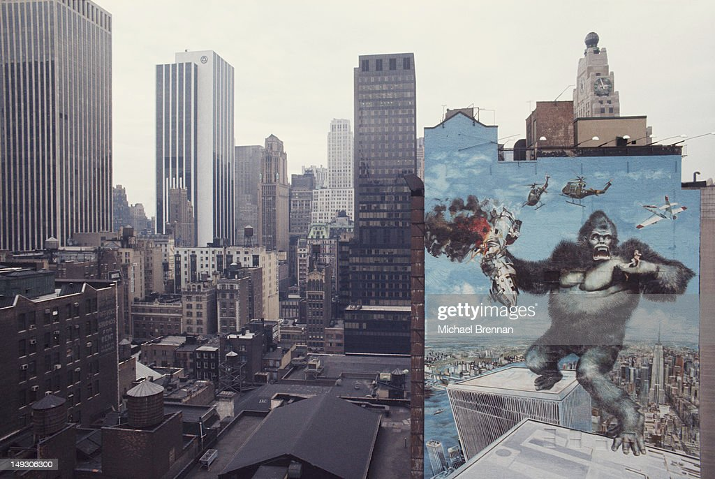 A large mural advertising the 1976 remake of the movie 'King Kong' on West 47th Street in Manhattan, New York City, circa 1976. The poster artist was John Berkey.