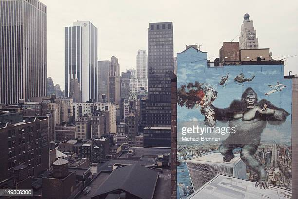 A large mural advertising the 1976 remake of the movie 'King Kong' on West 47th Street in Manhattan New York City circa 1976 The poster artist was...