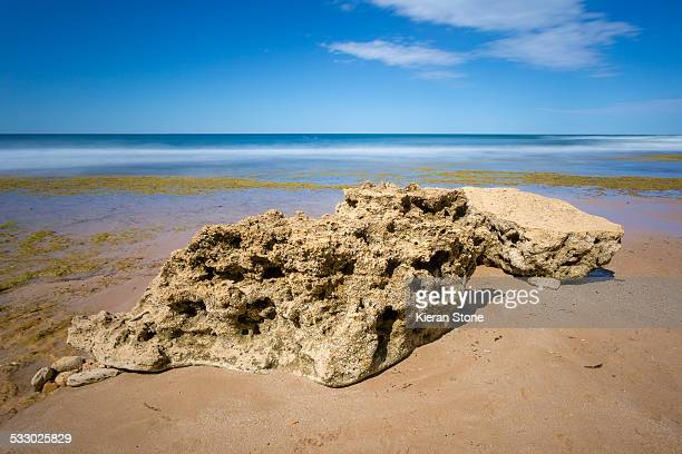 Large natural rock on beach