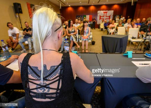 A large nazi eagle tattoo is seen on the back of Francesca Rizzi Italian autonomous nationalist as she attends an international far right conference...