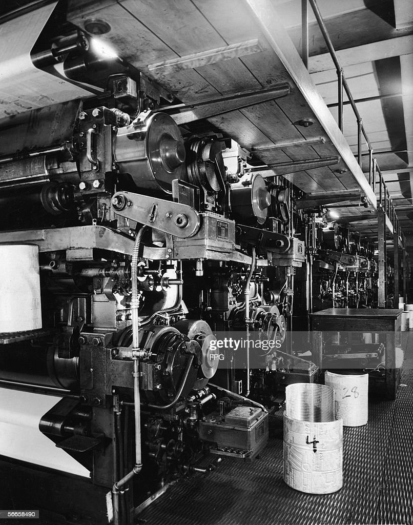 A Large Newspaper Printing Press Is Seen With The Stereotype Cylinders For Pages 4 And 28