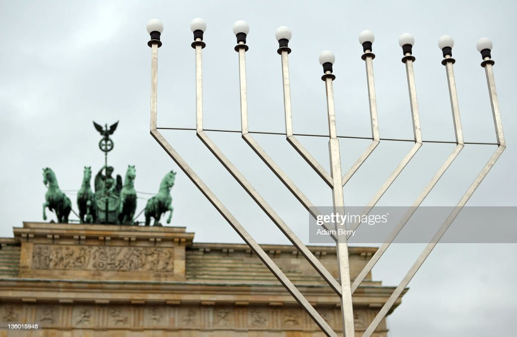 A large nine-armed candleholder, a Hannoukiah, or Menorah, stands ahead of the start of the eight-day-long and annual Jewish Festival of Lights known as Chanukah, in front of the Brandenburg Gate on December 20, 2011 in Berlin, Germany. The festival marks the rebellion of Maccabee Jews against the Greeks in 165 BC, which some believers say included a number of miracles pointing to divine providence.