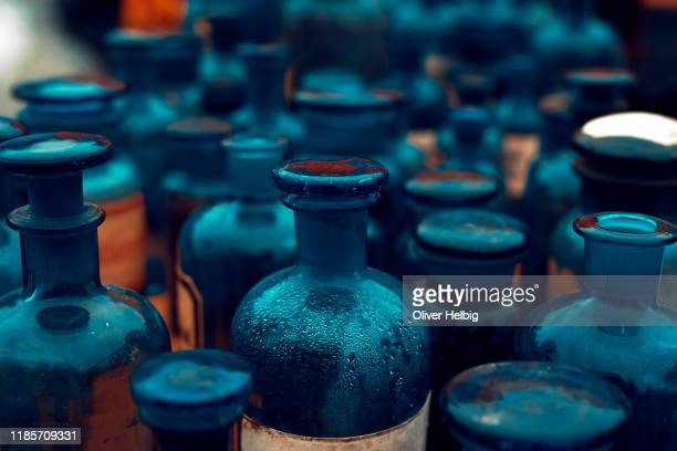 large number of antique pharmacy bottles made of blue glass - alchimie photos et images de collection