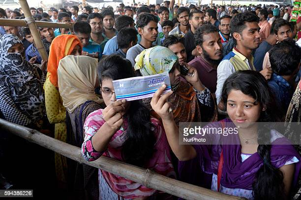 A large number of Bangladeshi people gather at the Gabtoli bus station to buy advance tickets in Dhaka on August 23 as Bangladesh Bus stations...