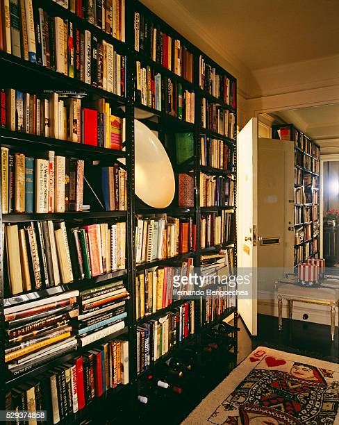 large number of books kept on the bookshelves with queen of hearts on the floor - fernando bengoechea stock pictures, royalty-free photos & images