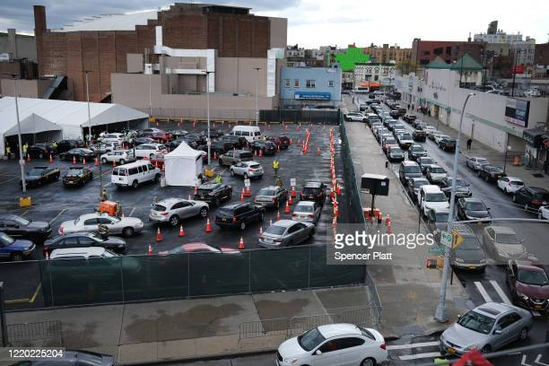 A large number of cars lineup at a recently opened coronavirus testing site on April 21 2020 in the Brooklyn borough of New York City New York City...