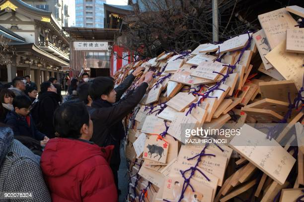 A large number of Ema wooden votive tablets with wishes on them are seen at Yushima Tenmangu Shrine in Tokyo on January 7 2018 Many students and...