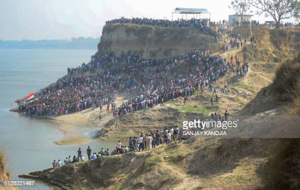 TOPSHOT A large number of mourners gather on the bank of the Ganges river to attend the funeral procession for Indian Central Reserve Police Force...