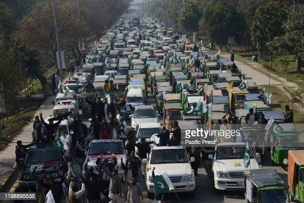 Large number of Pakistani members of Awami Pasban Rickshaw Union march a protest rally with their rickshaws against the high inflation rate, and...