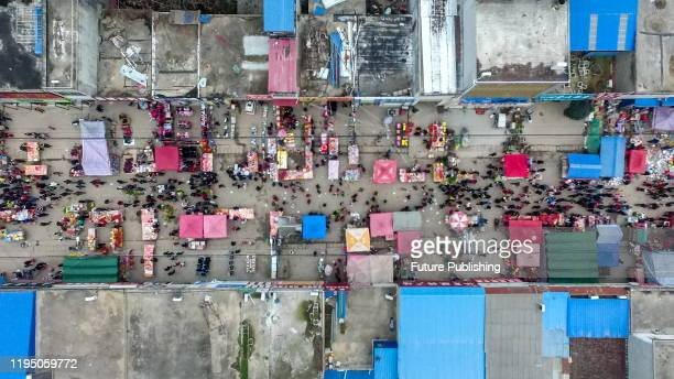 Large number of people come to the market to buy Lunar new year's goods, Zhengyang County, Henan Province, China, January 21, 2020. - PHOTOGRAPH BY...