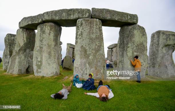 Large number of people enter the closed site at Stonehenge on June 21 in Amesbury, United Kingdom. English Heritage, which manages the site, said,...