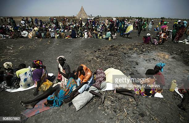 A large number of people wait for food airdrops by ICRC outside Thonyor in South Sudan on February 3 2016 The village suffered armed clashes in...
