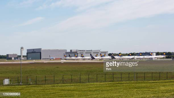 large number of permanently parked lufthansa-aircrafts due the corona crisis - airbus stock pictures, royalty-free photos & images
