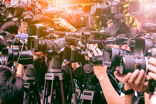 large number of press and media reporter in broadcasting event 697448616