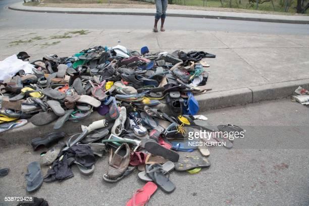 Large number of shoes and slippers are seen at the entrance to the University of Papua New Guinea following a protest rally by the students in Port...