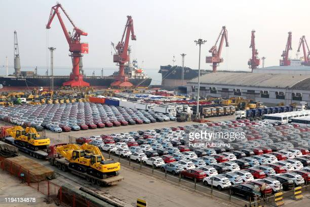 Large number of vehicles and machinery are assembled at the wharf waiting for shipment, Lianyungang City, Jiangsu Province, China, January 17, 2020....