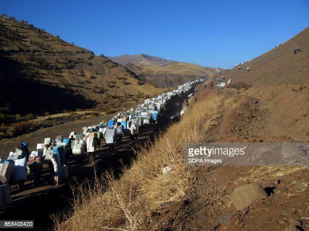 Large numbers of Kurds are crossing the border carrying heavy boxes to earn money For decades the IraqIran border has served as a smuggling route...