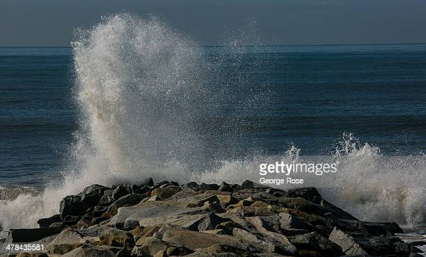 Large ocean waves batter a jetty at Will Rogers State Beach on March 3 in Santa Monica Beach California Millions of tourists flock to the Los Angeles...
